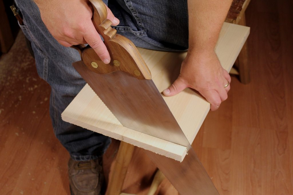 Crosscutting with a hand saw