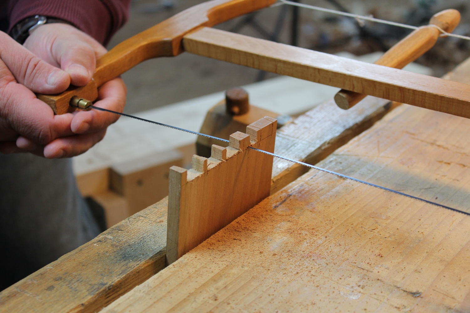 Sawing through dovetail pin waste