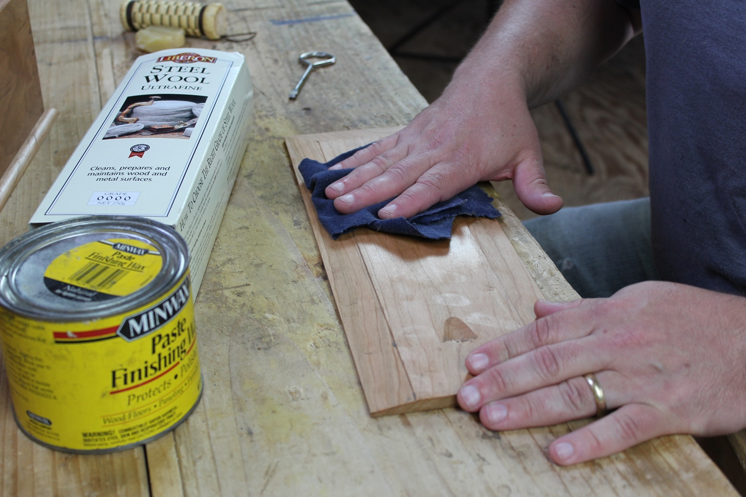 Buffing the waxed surface with cotton flannel